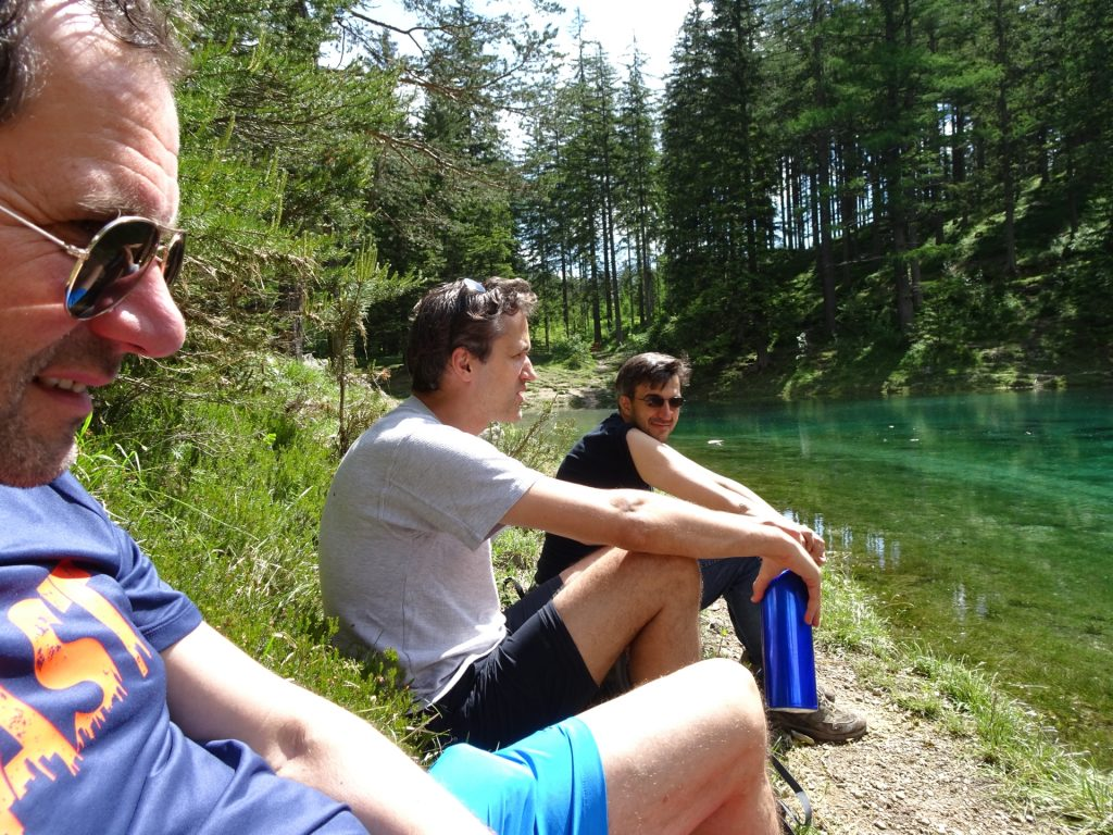 Hans, Bernhard, Robert C. are enjoying the sun at the score