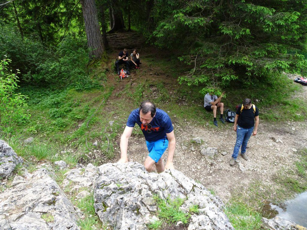 Hans climbing up the rock