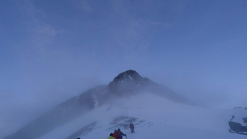 The summit becomes visible