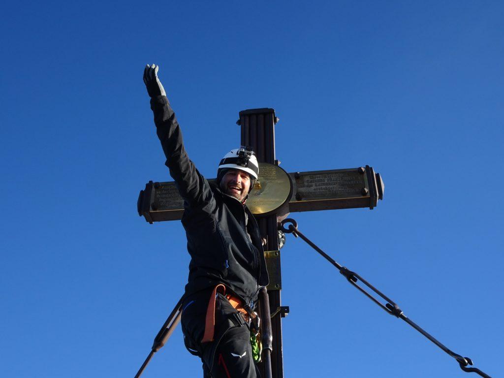 Stefan enjoying himself at the summit cross