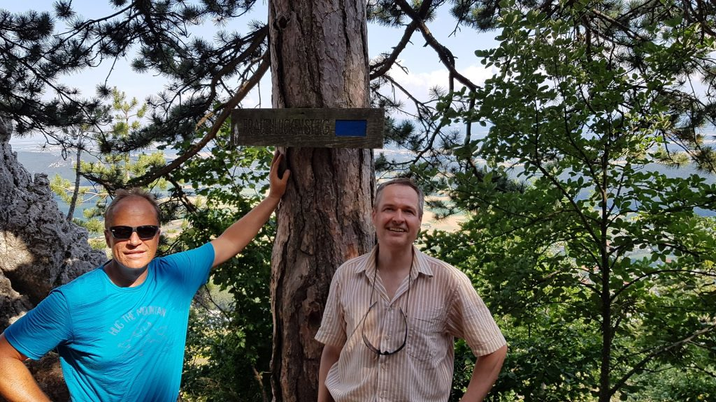 Werner and Herbert posing in front of the Signpost