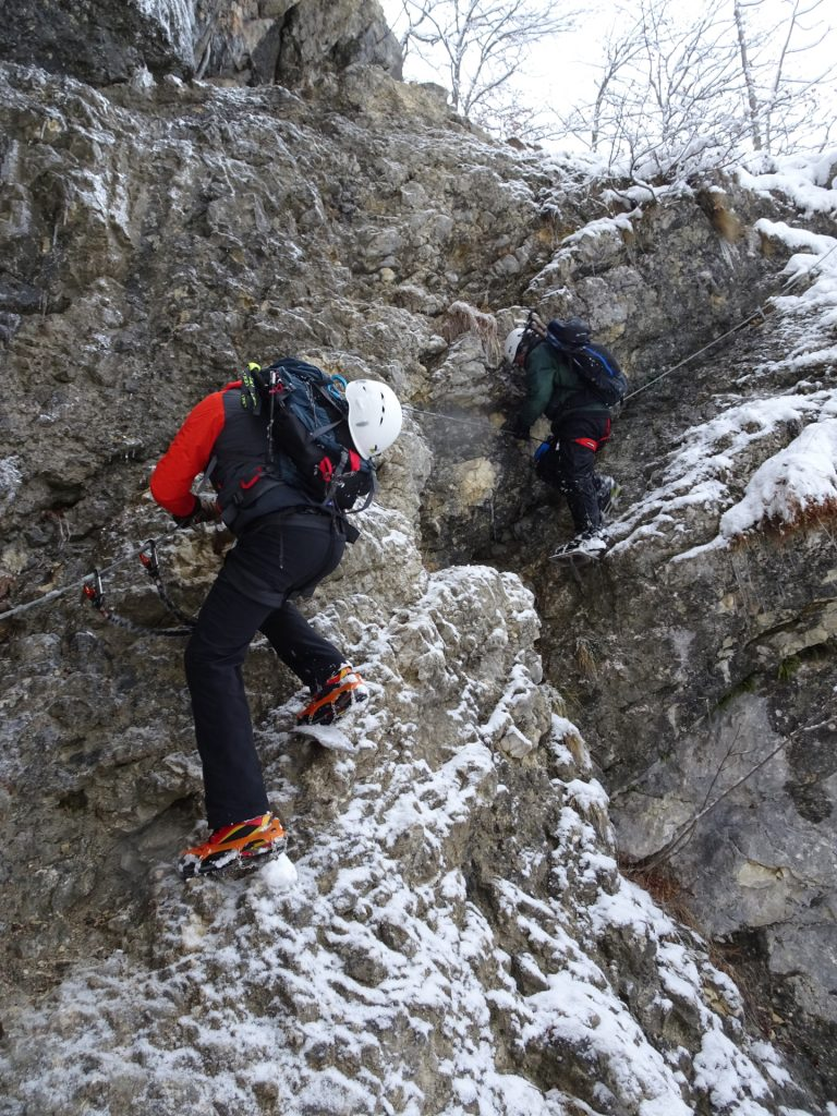Hannes and Robert on the icy rock at the entrance
