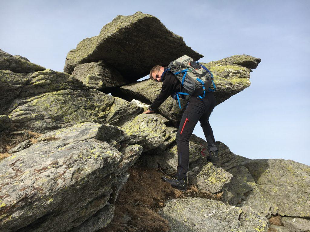 Stefan climbs up the rocks