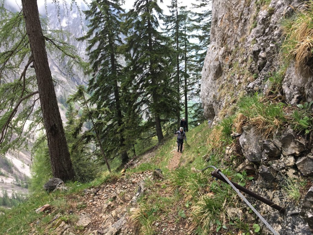 Stefan, Hannes and Nader are hiking up the trail in rain