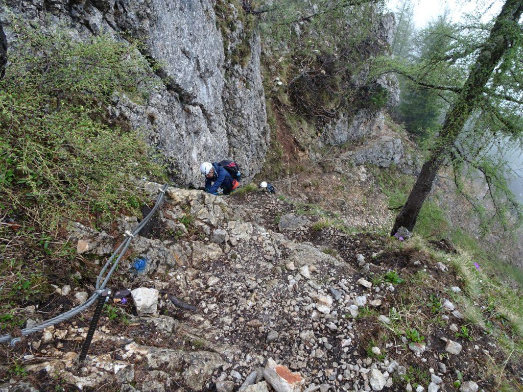 Climbing up on wet rocks