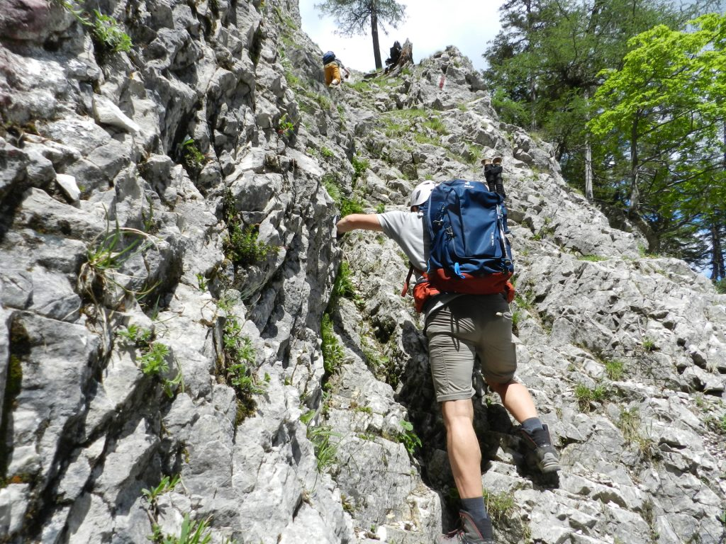 Nader climbs up (I-) towards the first part of the ferrata