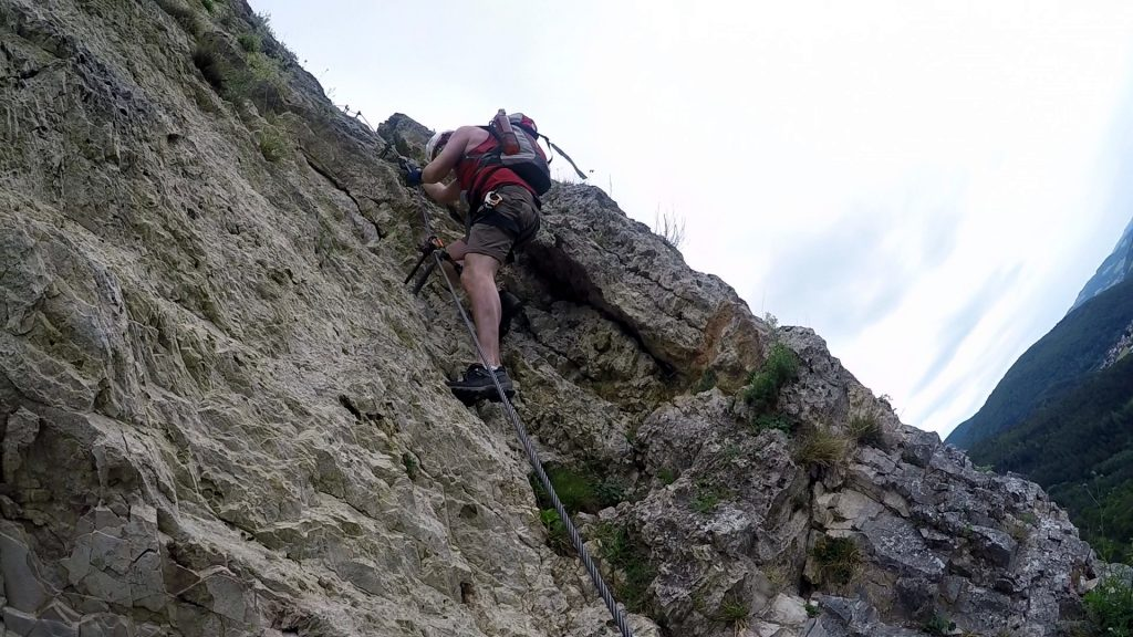 Hannes climbs up the crux of the ferrata