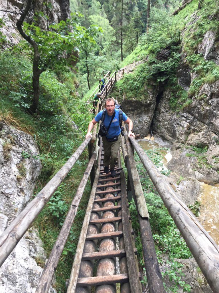 Hannes climbing up the wooden ladder