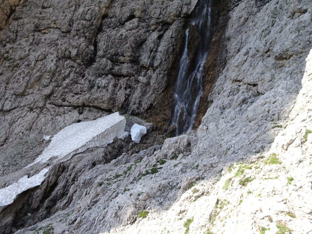 The permanent snowfield at the upper Pisciadù waterfall (rest area)
