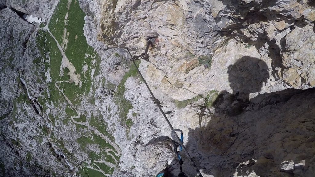 After the ladder, the final difficult part (short descent on an exposed traverse, B)