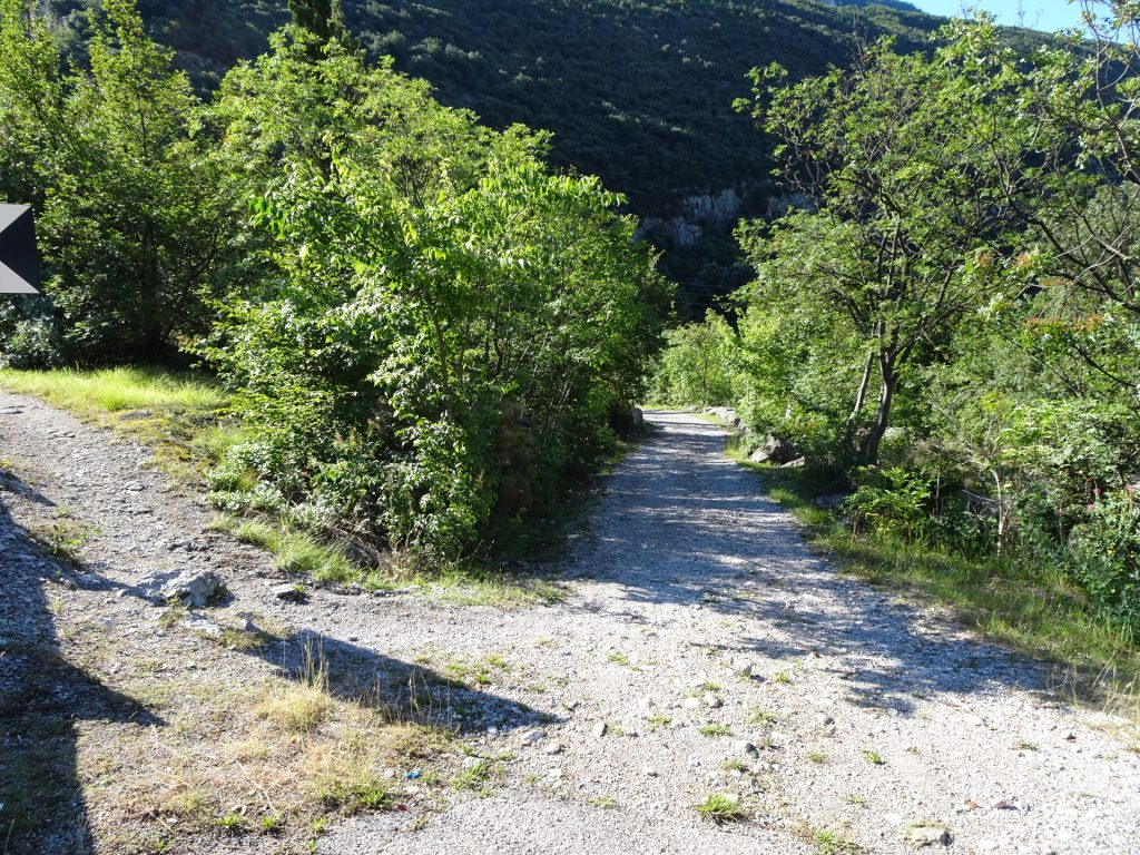 Follow the road downwards towards the entrance