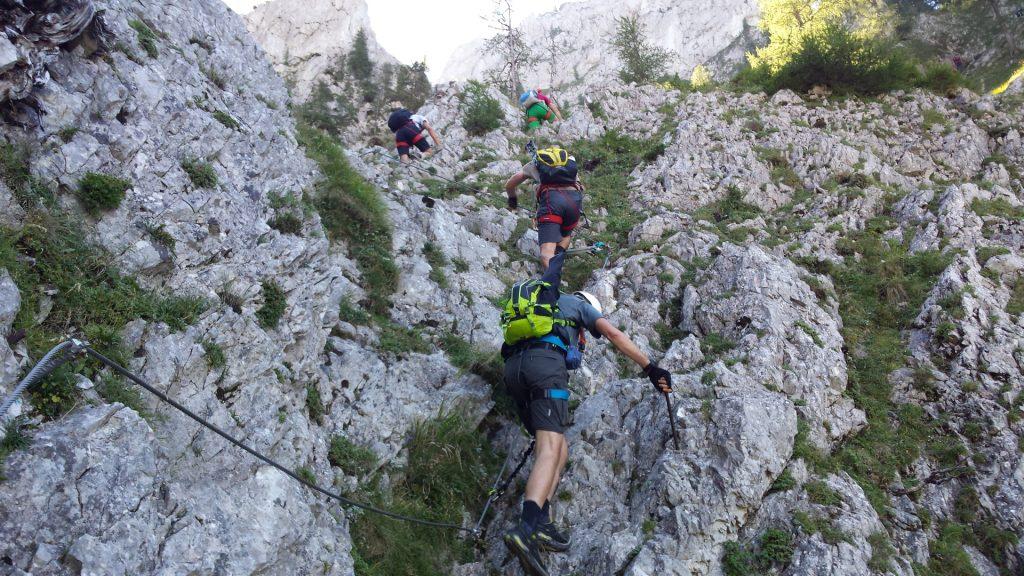 Bernhard, Robert and Stefan are climbing after the traverse