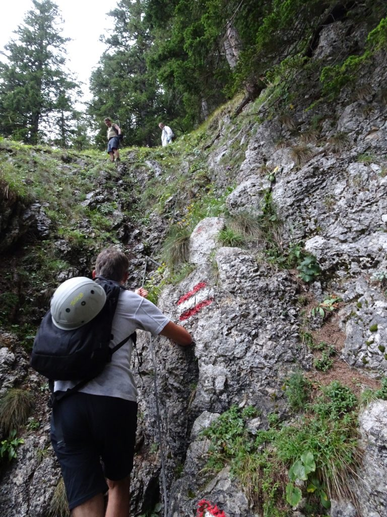 Bernhard climbs down on a steep and slippery when wet part