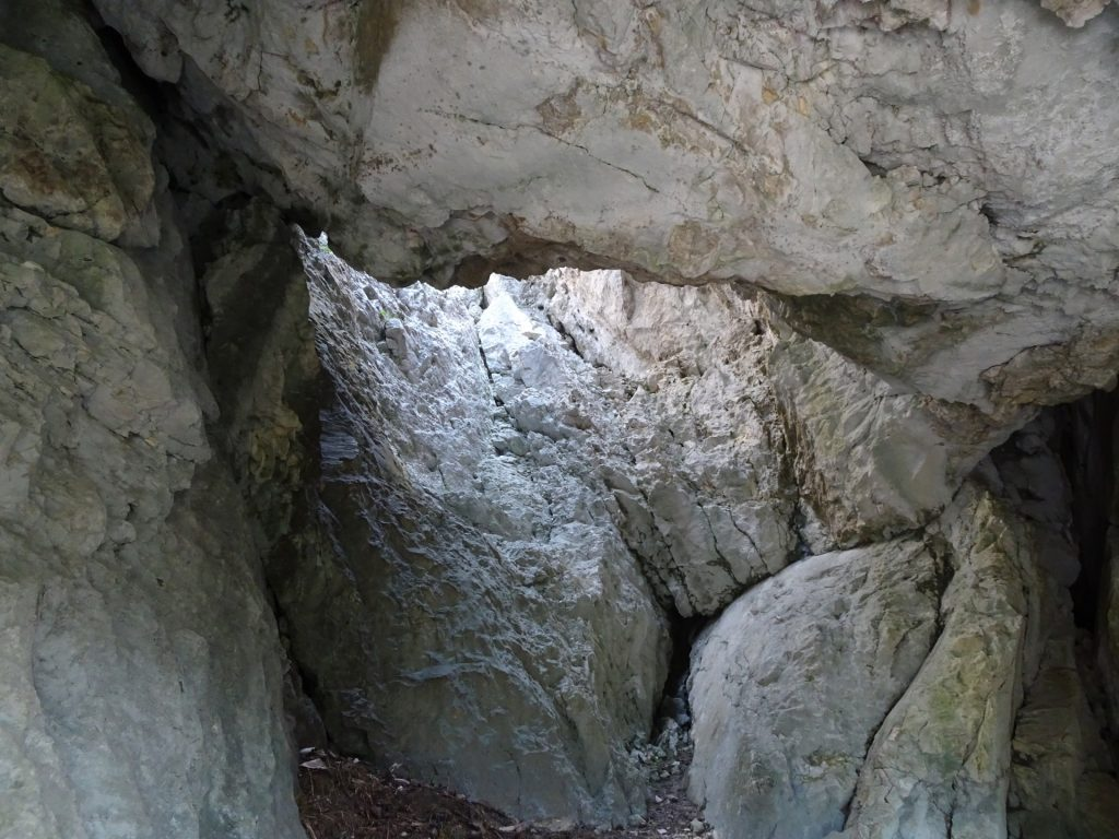 Looking inside the cliff cave