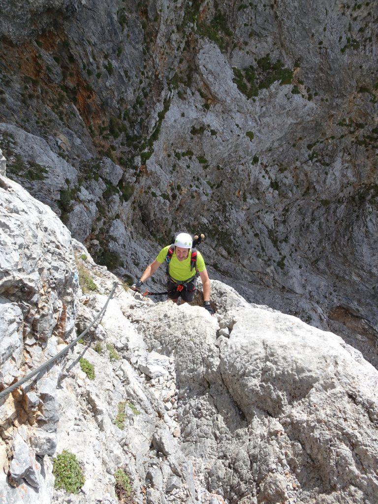 Hans climbs up the upper part of the ferrata