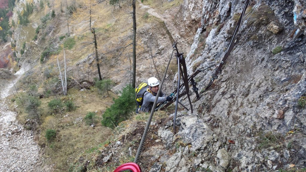 "Robert climbing up the long ladder towards ""Elsa-Rast"""