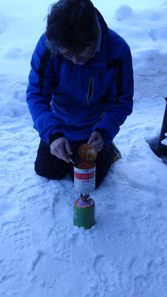 Robert preparing a warm meal